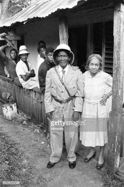 Colonel Walter James Robertson the elderly Jamaican Maroon Chief in full uniform with his wife and fellow maroons outside his house in St Elizabeth...