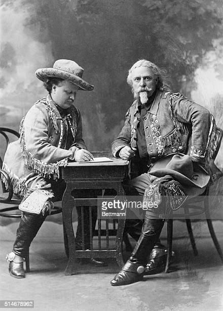 Colonel William Frederick Cody also known as Buffalo Bill sits across from his friend Colonel GW Lillie or Pawnee Bill as he writes