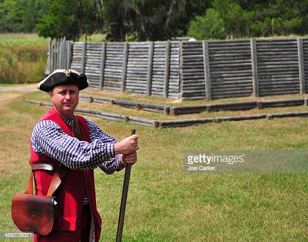 colonial british soldier with musket at fort - tricornered hat stock photos and pictures