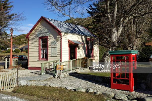 Colonial building with telephone box, Cardrona Hotel, Otago, New Zealand