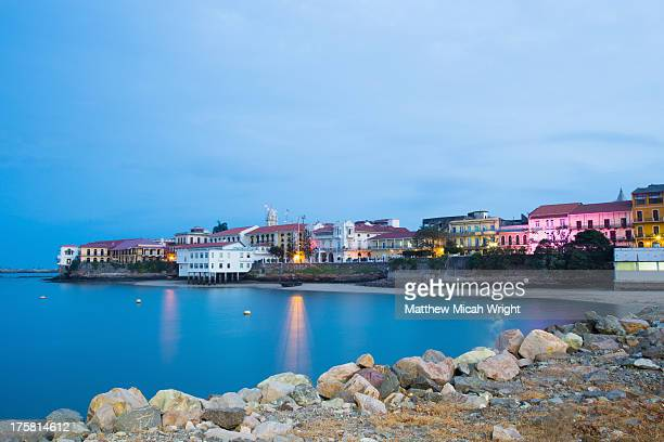 colonial buildings line casco viejo's waterfront - panama city panama stock pictures, royalty-free photos & images