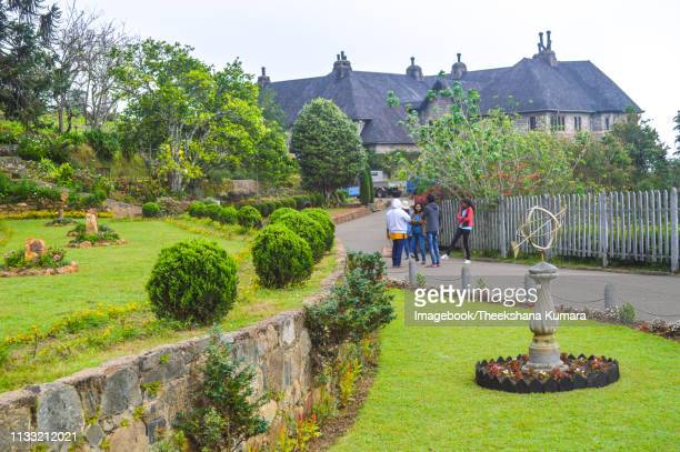 colonial bungalow hidden in mist - review of st benedict's monastery - adisham, haputale, sri lanka - imagebook stock pictures, royalty-free photos & images