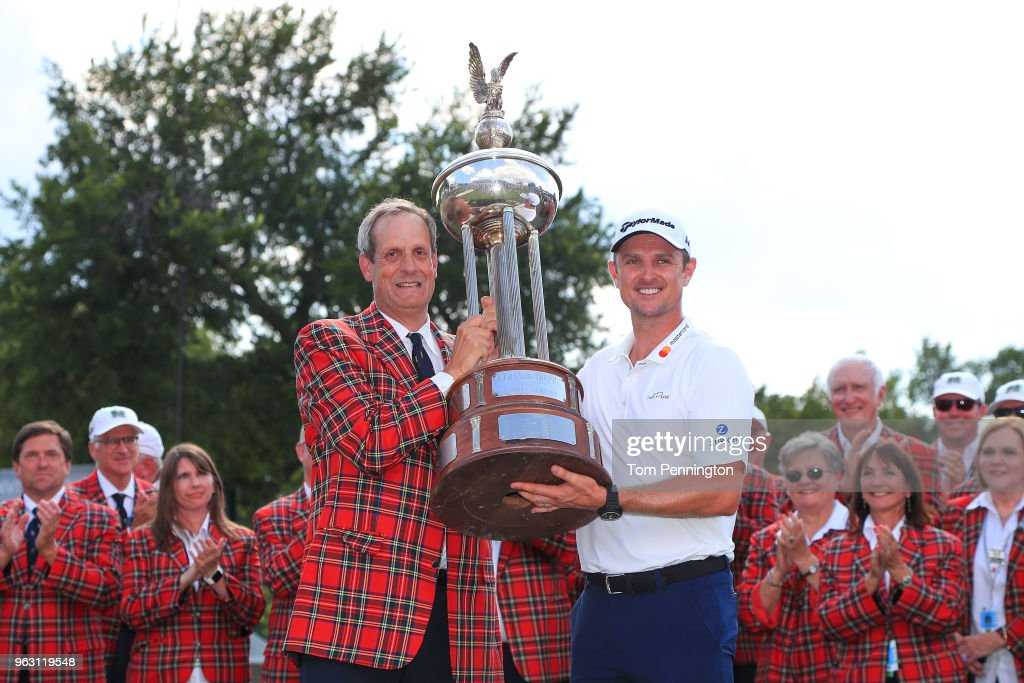 Colonial Country Club President Rob Doby presents the trophy to Justin Rose of England after he won the Fort Worth Invitational at Colonial Country Club on May 27, 2018 in Fort Worth, Texas.