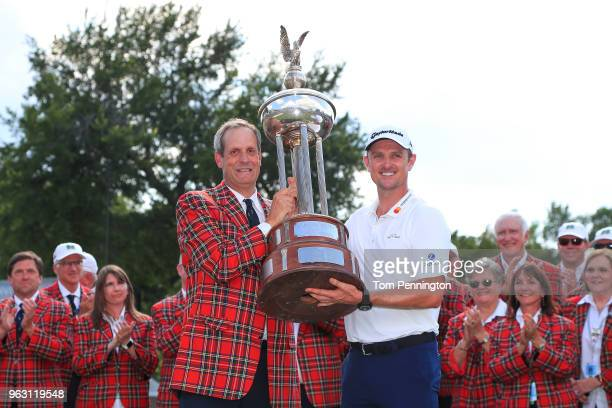 Colonial Country Club President Rob Doby presents the trophy to Justin Rose of England after he won the Fort Worth Invitational at Colonial Country...