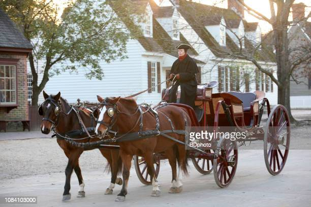 colonial era horse drawn coach in williamsburg, va - williamsburg virginia stock pictures, royalty-free photos & images