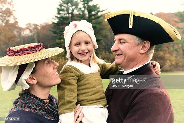 colonial family in period clothes - colonialism stock photos and pictures