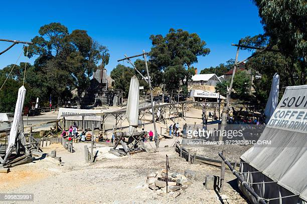 Colonial gold mine diggings and tents around a stream in a gold town museum Sovereign Hill Ballarat Victoria Australia