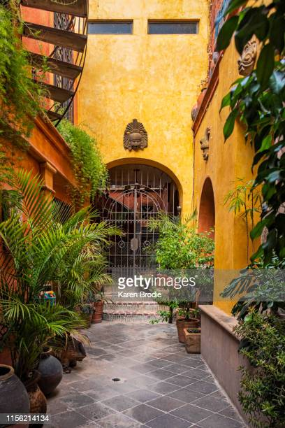 colonial home courtyard entrance - colonial stock pictures, royalty-free photos & images