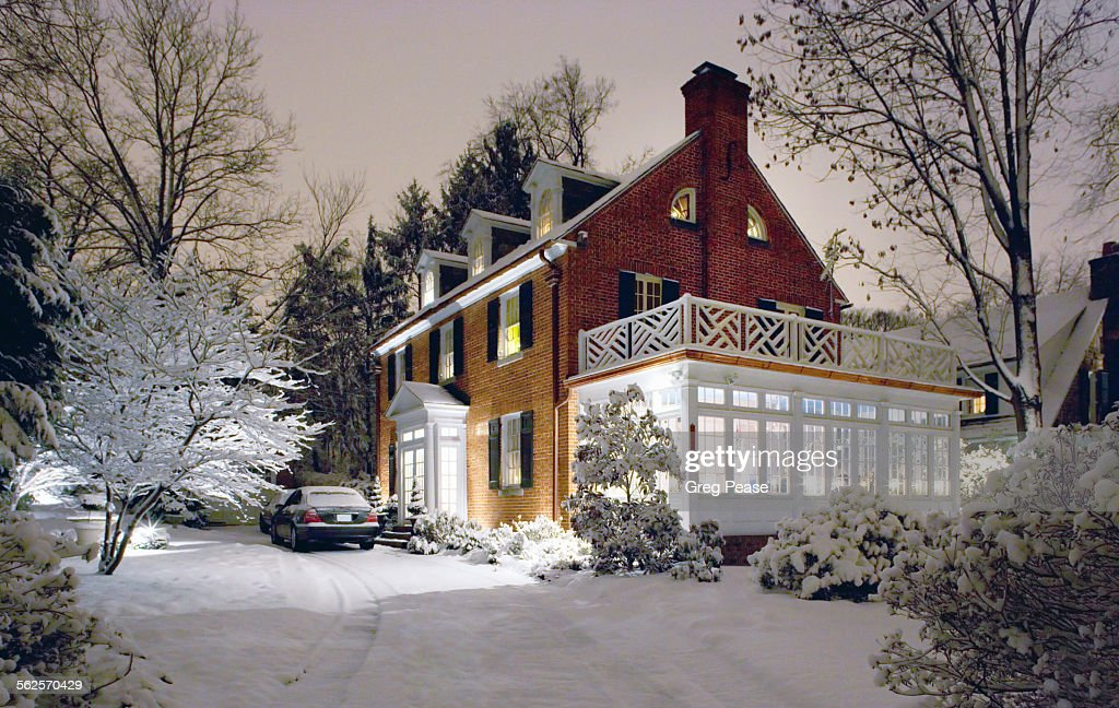 Colonial house on a snowy night : Stock Photo