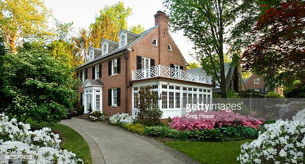 colonial house on a spring day - brick house stock pictures, royalty-free photos & images