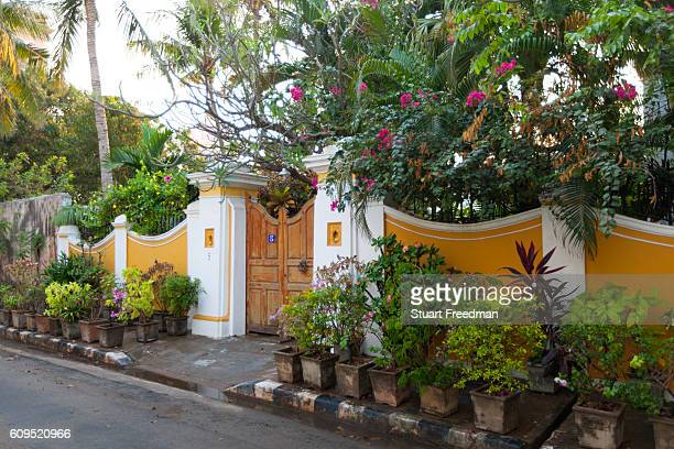 A Colonial house with many plants and flowers outside Pondicherry India Pondicherry is a Union Territory of India and was a French territory until...