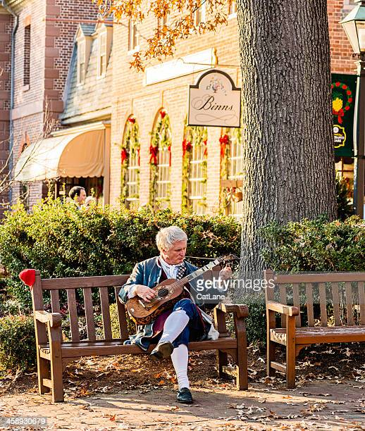 colonial man playing stringed instrument - williamsburg virginia stock pictures, royalty-free photos & images