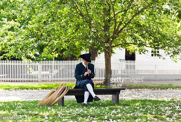 colonial man with flute - williamsburg virginia stock pictures, royalty-free photos & images