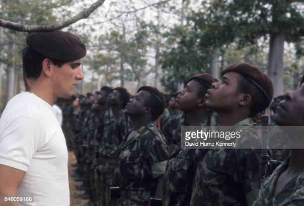 A Colonial Portuguese soldier inspects cadets during the Mozambican War of Independence Ancuabe Cabo Delgado Province Mozambique July 27 1973 The...