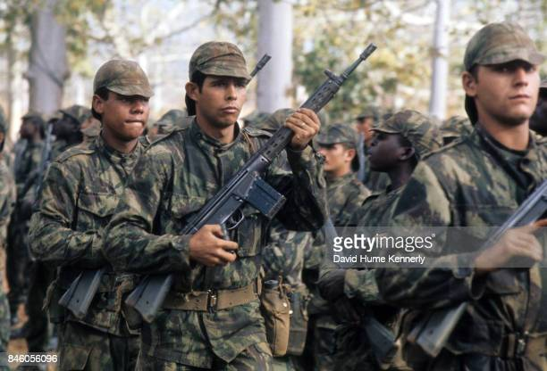 Colonial Portuguese soldiers present arms for an inspection during the Mozambican War of Independence Ancuabe Cabo Delgado Province Mozambique July...
