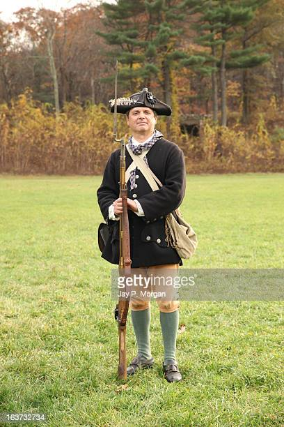 colonial soldier poses with rifle - colonialism stock photos and pictures