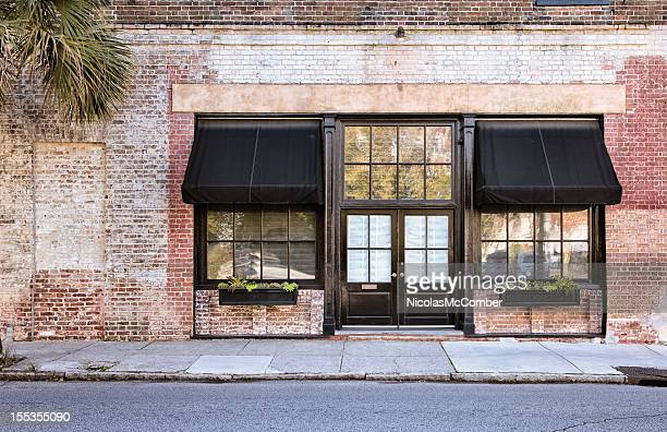 colonial storefront with awnings - curb stock pictures, royalty-free photos & images