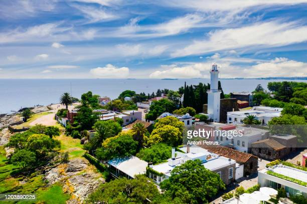 colonial street and houses at summer day. colonia del sacramento. uruguay. - latin america stock pictures, royalty-free photos & images