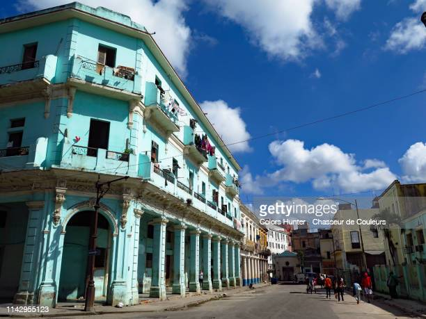 colonial style building and street life in havana - day of the week stock pictures, royalty-free photos & images