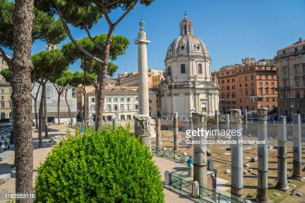 colonna traiana (trajan's column) and ss nome di maria church - image stock pictures, royalty-free photos & images