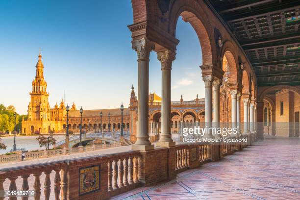 colonnade and arches, plaza de espana, seville - seville stock pictures, royalty-free photos & images
