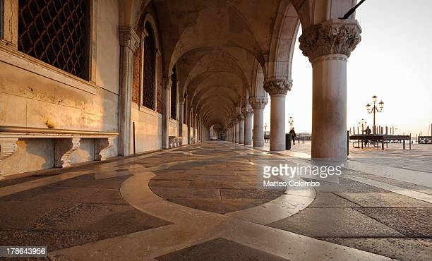 Colonnade of Doges palace in Venice Italy