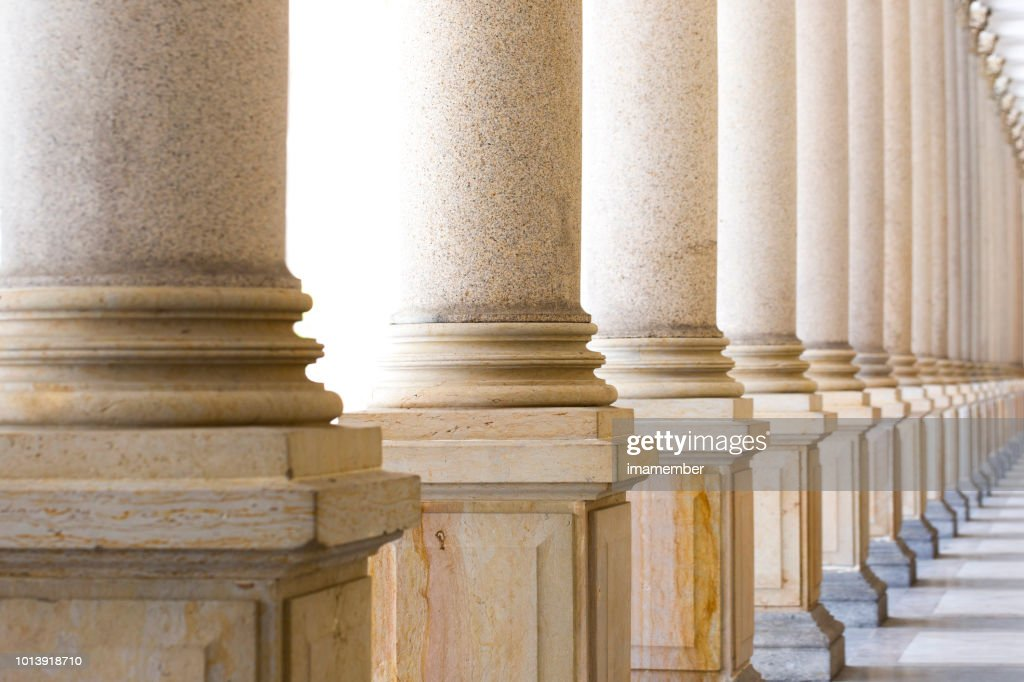 Colonnade, row of classical stone columns, background with copy spaced : Stock Photo