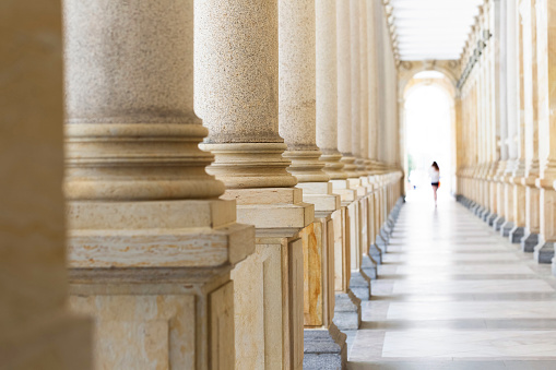 Colonnade, row of classical stone columns, background with copy spaced 1032922614