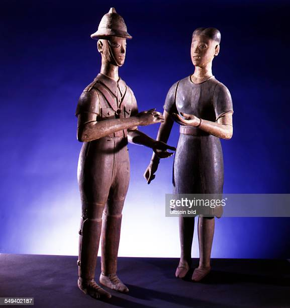Colons from Ghana before 1914 a British colonial officer and his wife statue