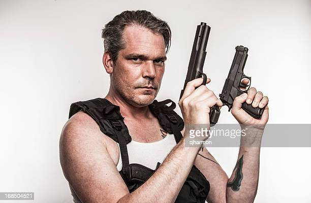 Color Action Hero Wielding Two Handguns Wearing Tactical Vest Gritty