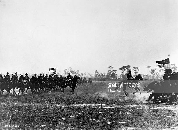 Color bearers lead an attack by the US Third Cavalry during the SpanishAmerican War in 1898