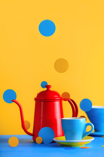 Color block coffee equipment still life. Kettle and porcelain coffee cups on a vibrant yellow background. Geometry and color in food photography. Suprematic concept with copy space - gettyimageskorea