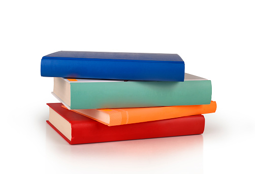 color books stack isolated 1043539364