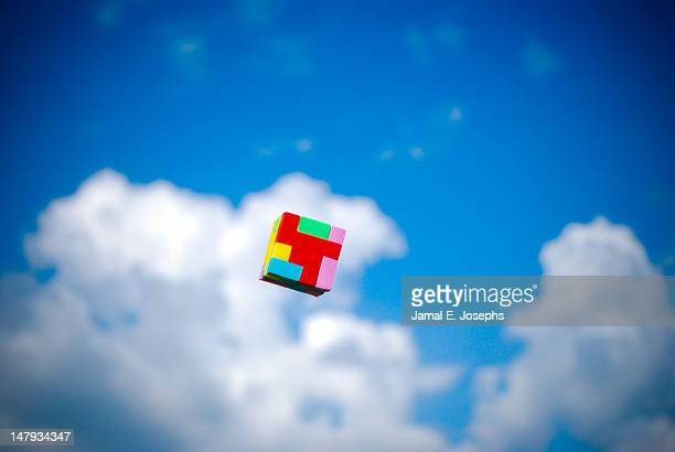 Color cube against blue sky