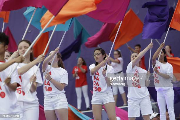 Color guard performers wave flags during the Canada Day event on Parliament Hill in Ottawa Ontario Canada on Saturday July 1 2017 The 150th...