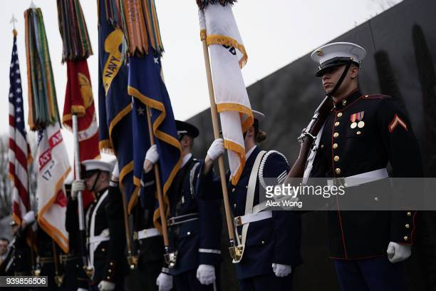Color guards participate in a ceremony at the Vietnam War Memorial March 29 2018 in Washington DC The Defense Department and The Veterans Affairs...