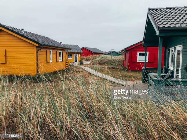 color houses in dune island. - helgoland stock pictures, royalty-free photos & images
