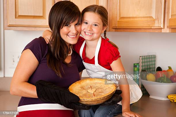 Color Image of Mother and Daughter Showing Pie They Baked