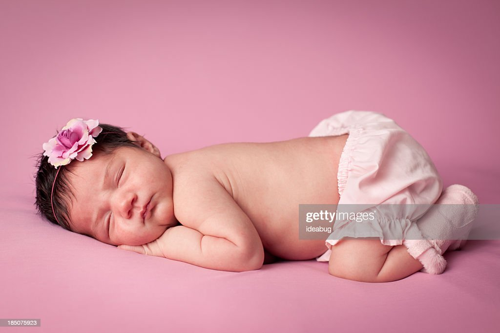 Color Image of Precious Newborn Baby Girl, on Pink Background : Stock Photo