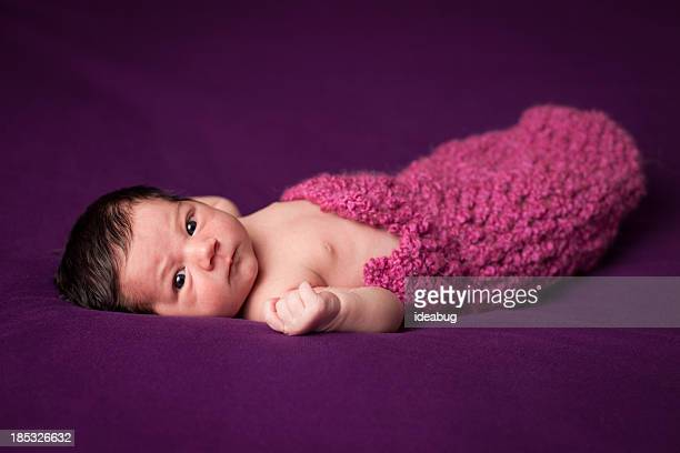 Color Image of Precious Newborn Baby Girl, on Purple Background