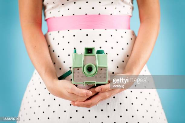 Color Image of Retro Gal Holding a Vintage Camera