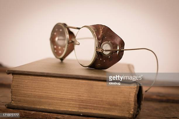 color image of vintage, round, wire, steampunk eyeglasses - golden goggles stock pictures, royalty-free photos & images