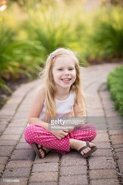 Color Image of Young Girl Sitting Outside