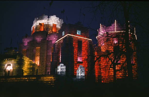 Color lights illuminate the Ice Palace at night during the StPaul Winter Carnival in StPaulMinnesota