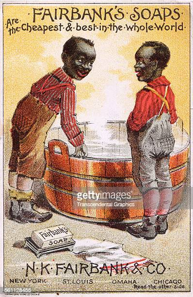 A color lithographed Victorian era trade card designed to promote Fairbanks Soap using a racist cartoon with AfricanAmerican boys New York New York...