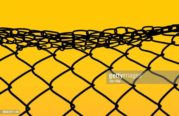 Color manipulated image of a damaged chainlink fence against vibrant yellow background