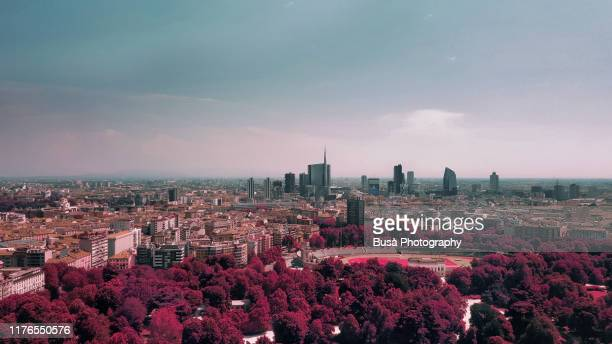 color manipulation of view of the porta nuova downtown district from parco sempion. milan, italy - milano foto e immagini stock