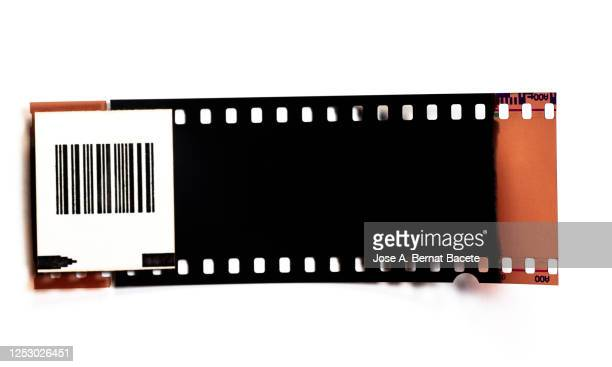 color negative 35mm film stripes on a white background. - film stock pictures, royalty-free photos & images
