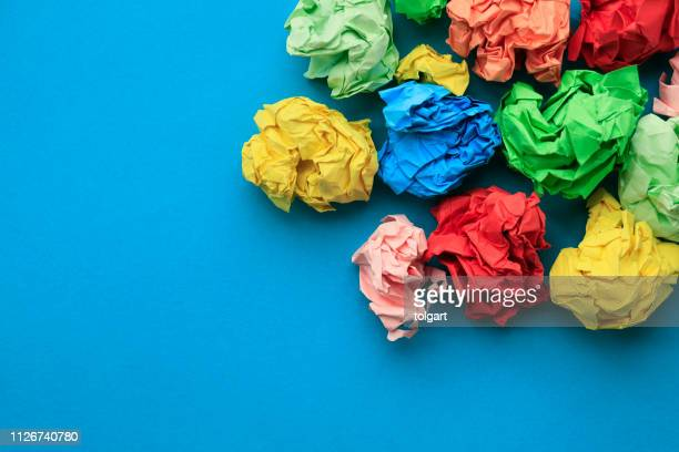 color paper balls - paperboard stock photos and pictures