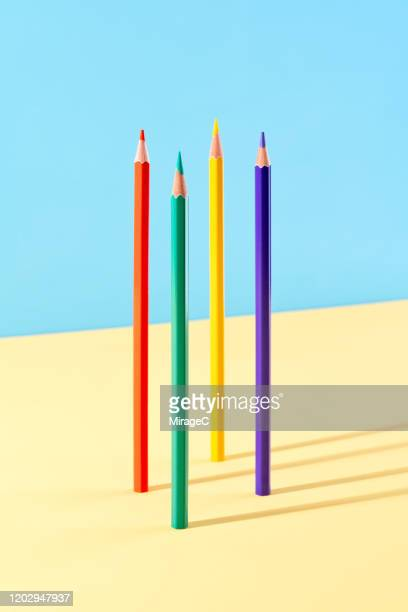 color pencils standing on colored background - vertical stock pictures, royalty-free photos & images